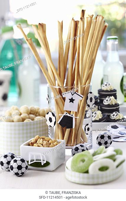 A buffet laid with snacks and football decorations