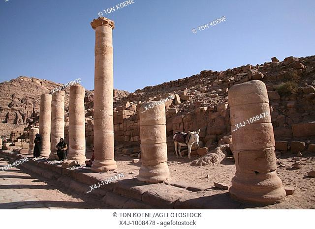 An excavated building with pillars in Petra, an ancient city in the southwest of Jordan, hewn from towering walls of rock