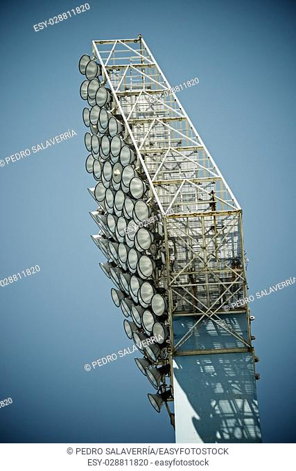 Closeup of a stadium lights with blue sky
