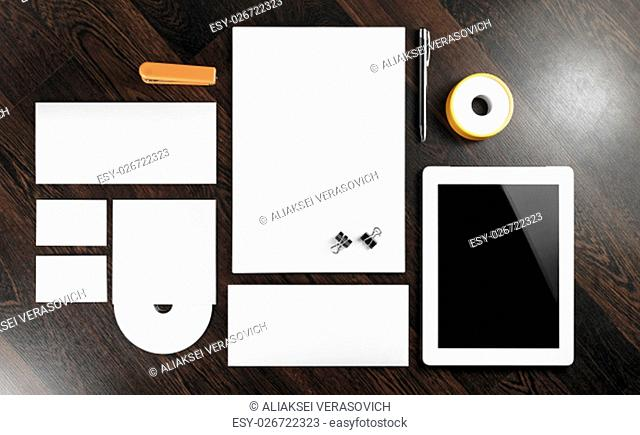 Blank corporate identity template on dark wooden background. For design presentations and portfolios