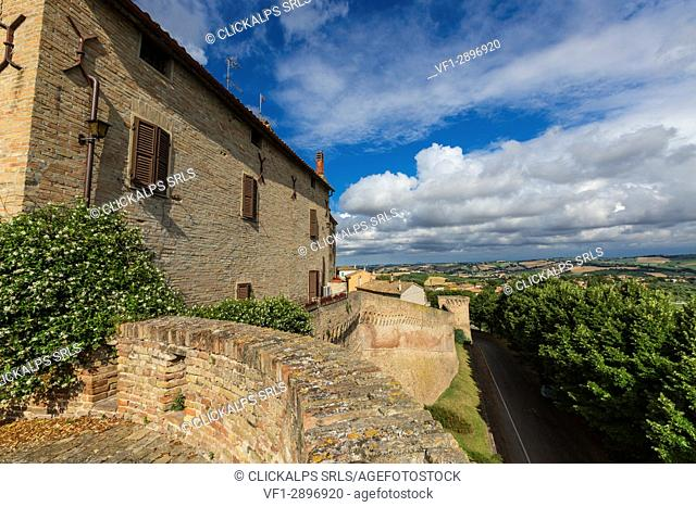 Blue sky frames the typical buildings of the old town surrounded by fields Corinaldo Province of Ancona Marche Italy Europe