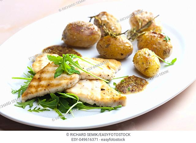 Still lifegrilled cod with potatoes