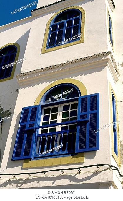 Town. Medina, centre. House. Rounded arches, windows. Balcony shutters, blue paint