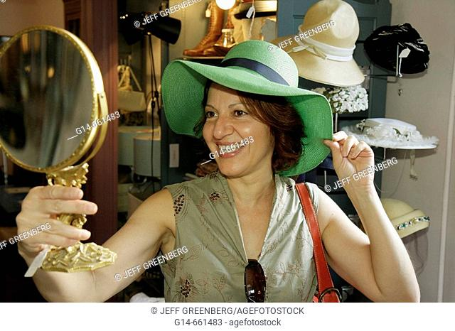 Pennsylvania, Pocono Mountains, Hawley, Church Street, Miss Elly's Antiques, collectibles, hat, woman, mirror, shopping