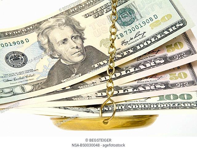 dollar banknotes scale pan