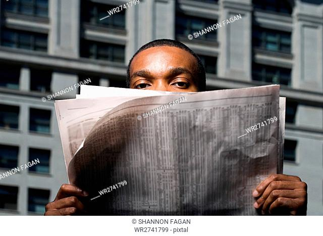 Man looking over newspaper
