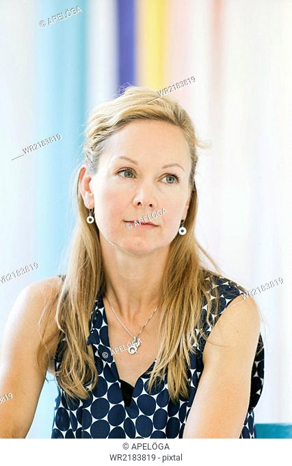 Thoughtful mature woman in coffee shop