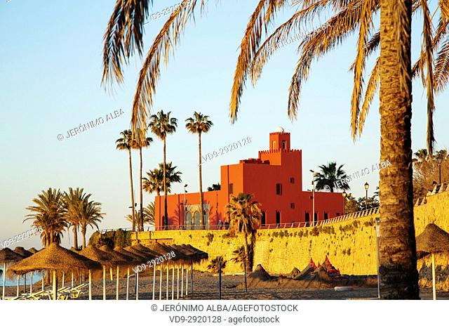 Beach at sunrise. Bil-Bil castle built in neo-Arab style in 1934, Benalmadena. Malaga province Costa del Sol. Andalusia Southern Spain, Europe