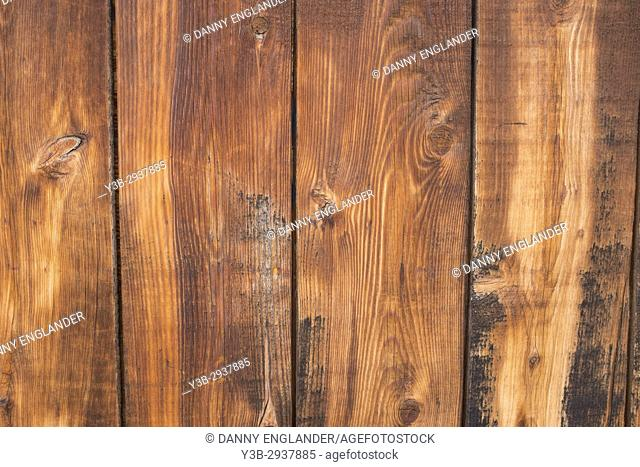 Close-up detail of grainy wooden fence planks