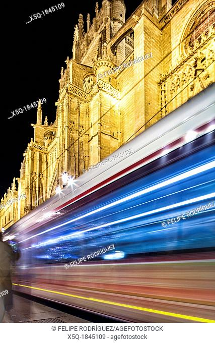 Streetcar passing by in front of Seville's Cathedral, Spain