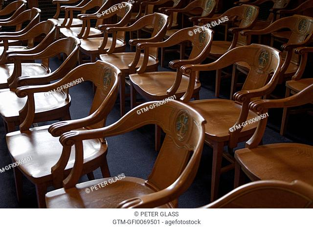 Wooden spectators' chairs in a courtroom