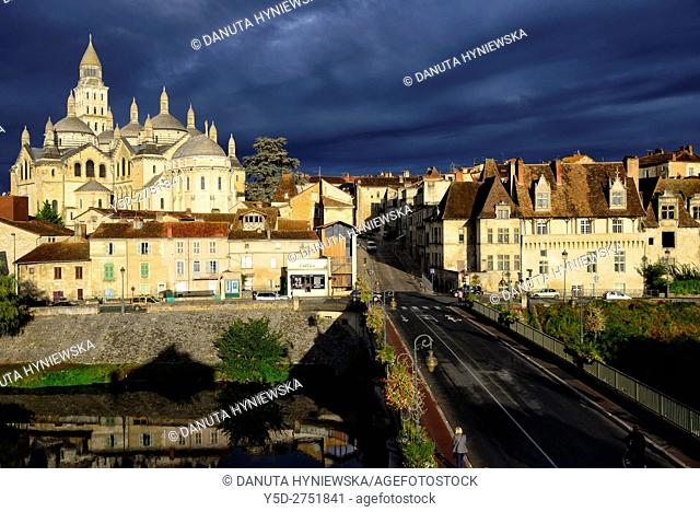 Panoramic view of Old Town of Périgueux with dark sky, in front Saint-Front Cathedral and bridge Pont des Barris over Isle river, Périgueux