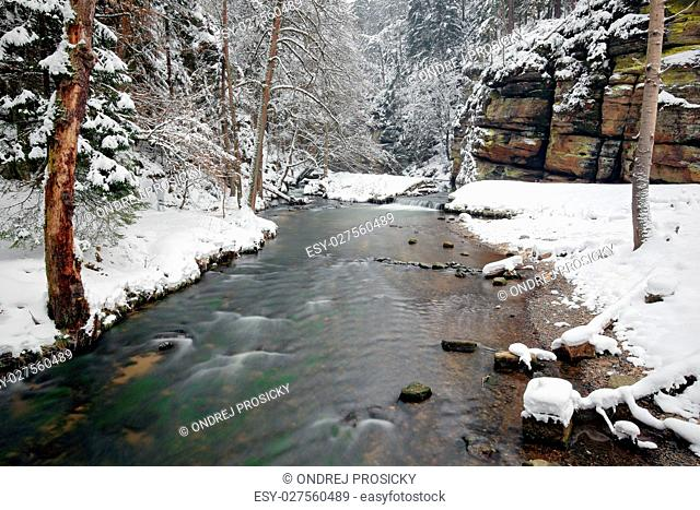 Winter landscape with white river