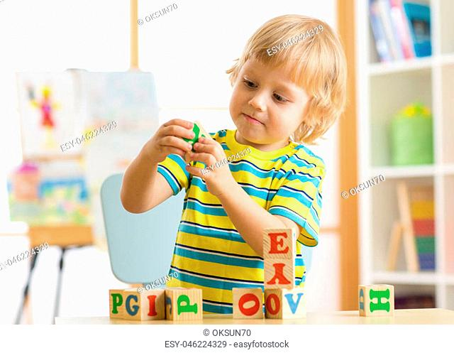 child playing with block toys and learning letters
