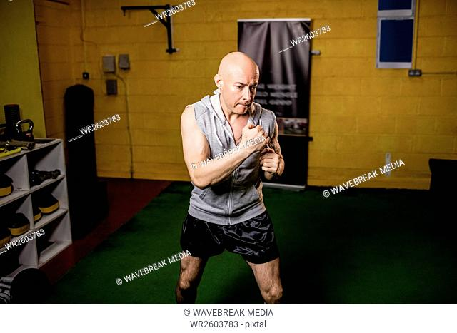 Thai boxer practicing boxing