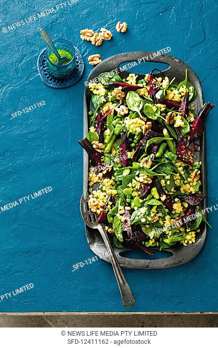Lentil salad with beans, beetroot, spinach, walnuts and a ginger dressing