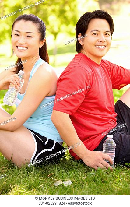 Asian couple resting after exercise