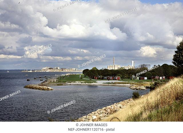 View of beach with cloudy sky
