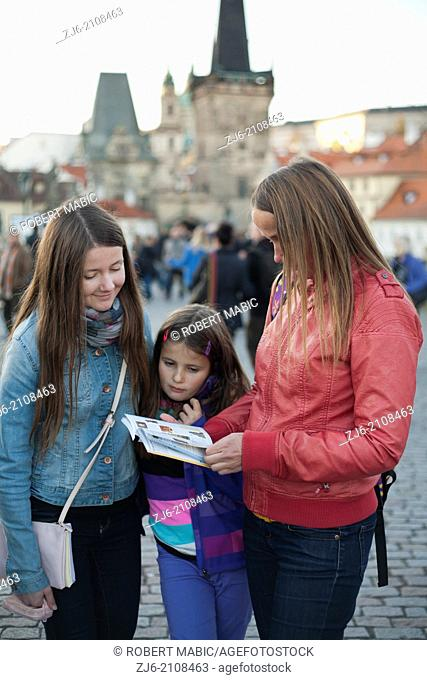Family with a guide. Karluv Most - Charles Bridge. Prague