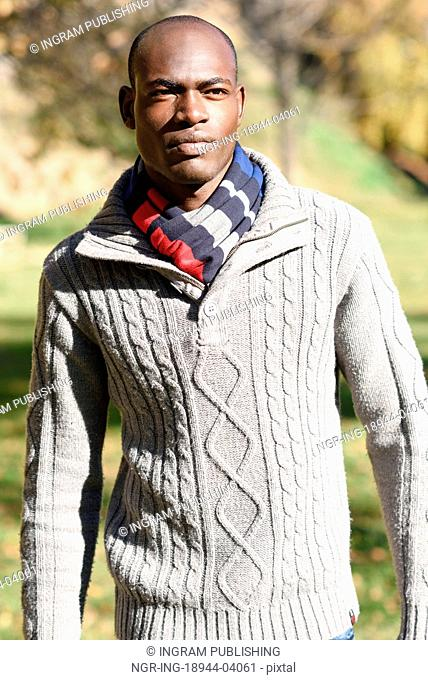 Portrait of black man wearing casual clothes in urban background