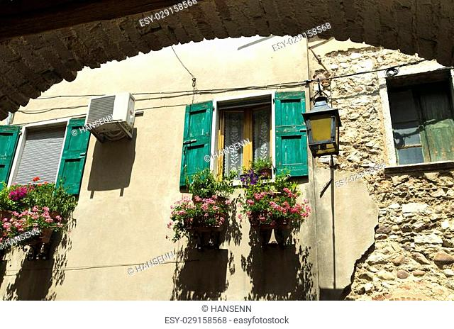 picturesque house facade in Lazise, Italy. It,s a wellknown village by tourists directly situated at the laggio del garda