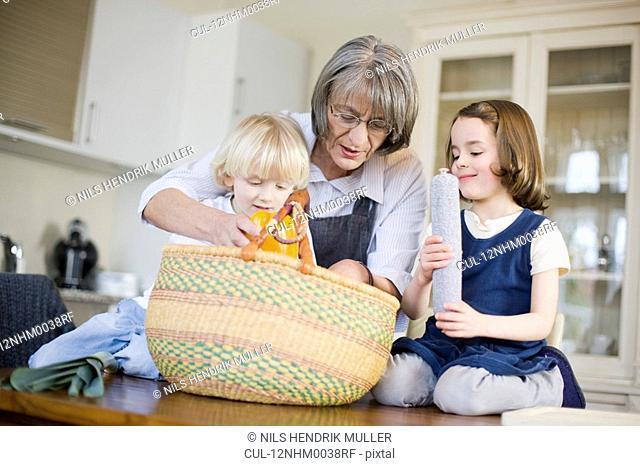 grandmother and grandchildren packing