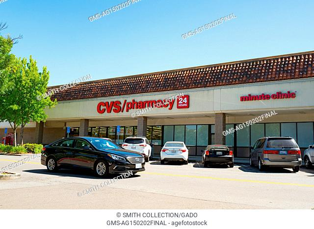 A car drives past a CVS Pharmacy on a sunny day in San Ramon, California, May 31, 2017