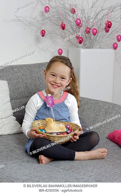 Child, little girl with Easter basket, nest and paschal lamb, Upper Bavaria, Bavaria, Germany