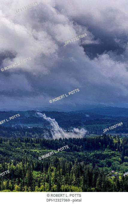 Clouds darken the landscape of Northern Oregon; Astoria, Oregon, United States of America