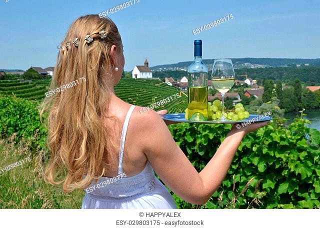 Girl holding wine and grapes. Vineyards of Rheinau, Switzerland