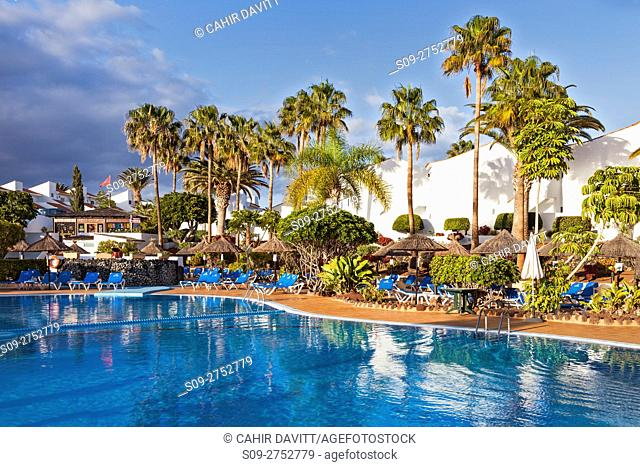 Holiday apartment complex and pool in Golf del Sur, Santa Cruz de Tenerife, Tenerife, Canarias, Spain
