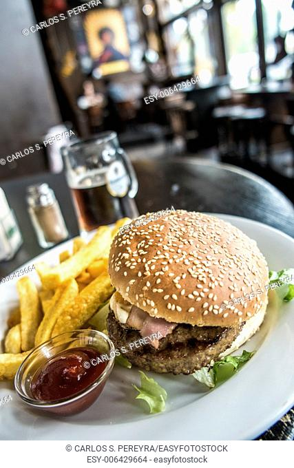 Hamburger and beer in a pub