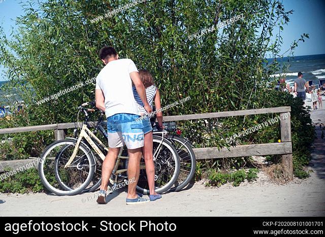 Poland, Jurata 16.08.2015. Boy and girl leave their bikes in the entrance to the beach. Photo CTK/Grzegorz Klatka