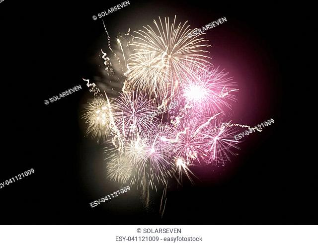 A large bright fireworks display event with gold and pink rocket breaks