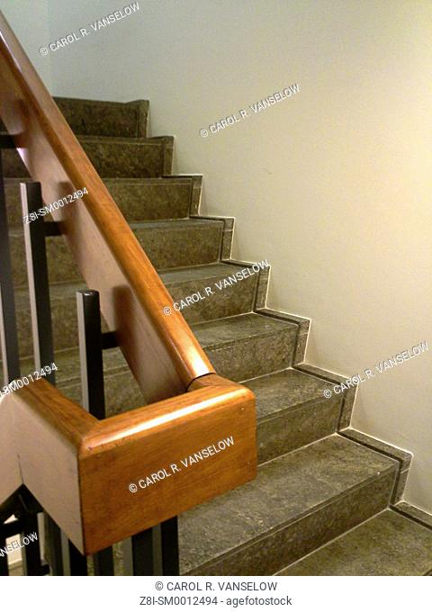 Stairwell in building. One flight of stairs