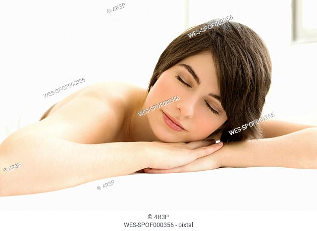 Germany, Bavaria, Munich, Young woman relaxing, close up