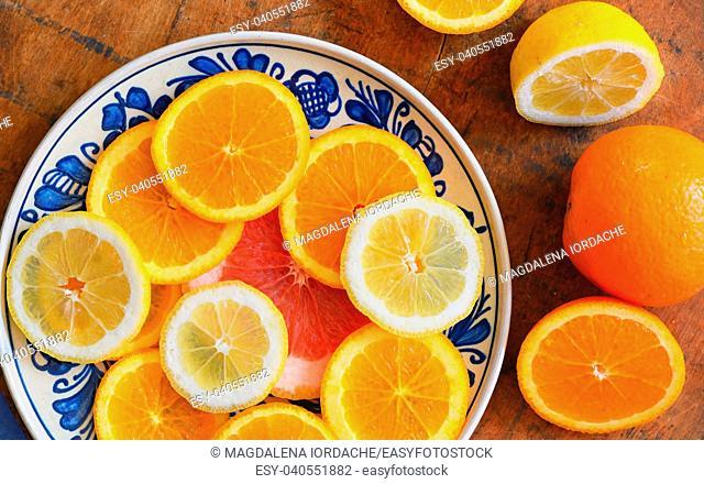 citrus fruit slices on vintage plate