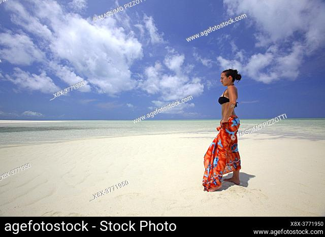 Young girl on the beach of Kapalai Island, Borneo, Malaysia