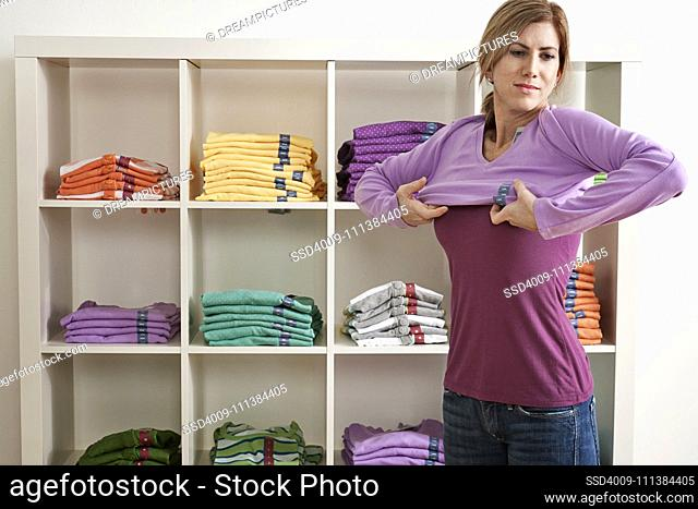 Caucasian woman trying on clothes