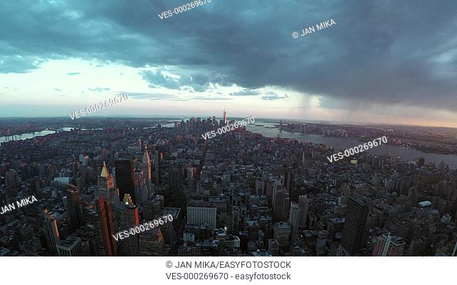 New York City skyline and dramatic sky wide angle view at sunset in the United States of America