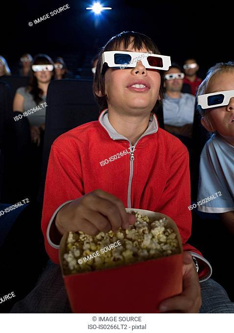 A boy watching a 3d movie