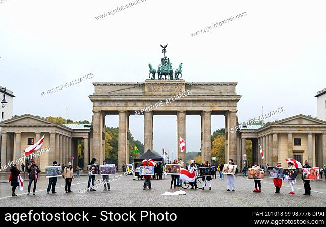 18 October 2020, Berlin: Several people are protesting in front of the Brandenburg Gate against the Belarusian head of state Lukashenko