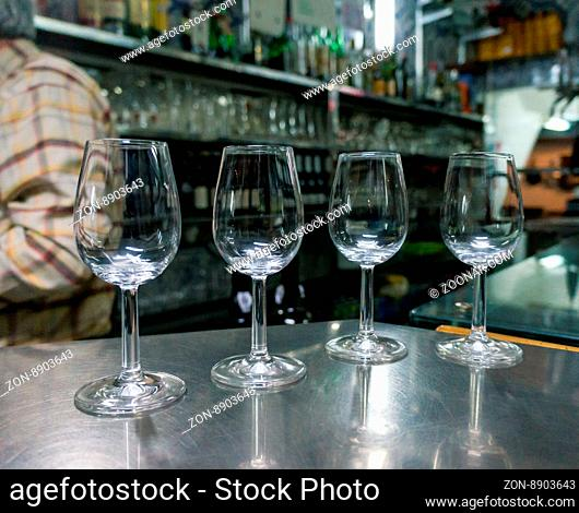 Empty glasses for wine on the table at bar