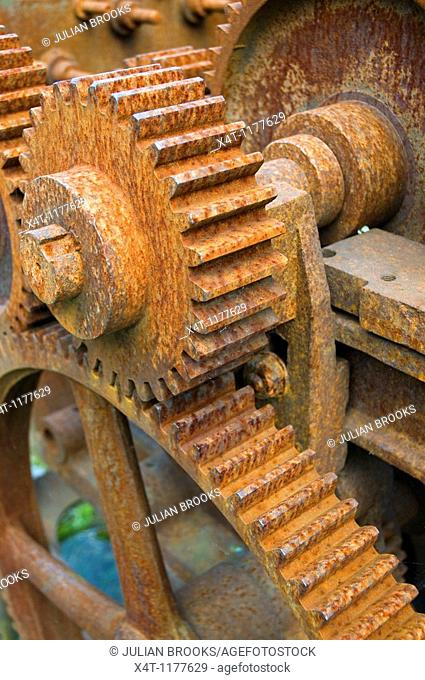 Rusty machinery with cogs and gears, used for rope making