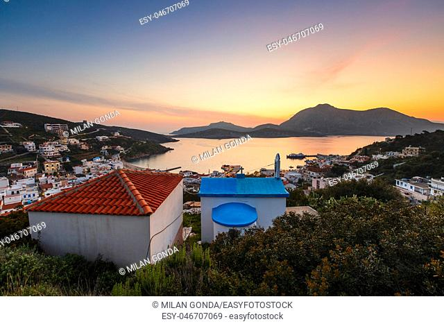 Small church overlooking the main village of Fourni island, Greece.