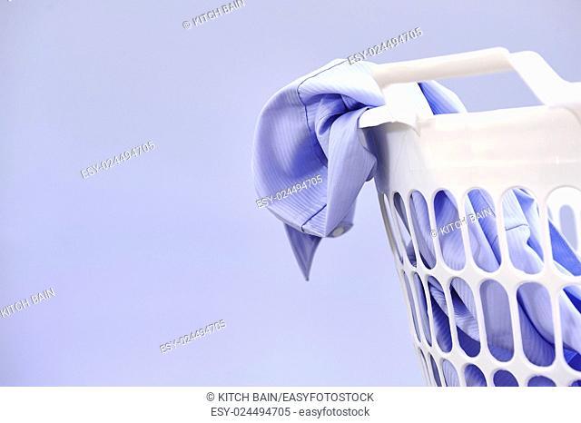 A studio photo of a laundry washing basket