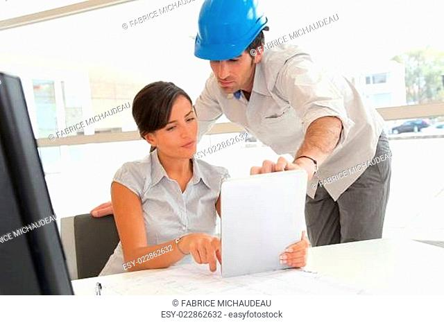 Architects working in office with electronic tablet