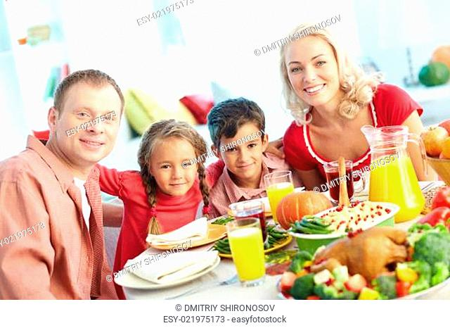 Family by festive table