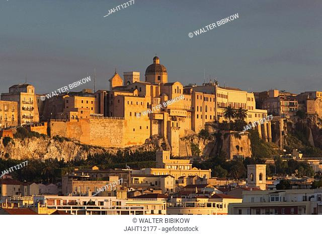 Italy, Sardinia, Cagliari, Il Castello Old Town and city walls from Basilica Nostra Senora di Bonaria, sunrise