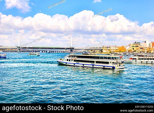 Metro bridge and touristic boats on Bosphorus in Golden Horn, Istanbul